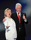Former United States President Bill Clinton and Hillary Clinton, the Democratic Party nominee for President of the United States, on the podium as they anticipate the balloon drop following her acceptance speech during the fourth session of the 2016 Democratic National Convention at the Wells Fargo Center in Philadelphia, Pennsylvania on Thursday, July 28, 2016.<br /> Credit: Ron Sachs / CNP<br /> (RESTRICTION: NO New York or New Jersey Newspapers or newspapers within a 75 mile radius of New York City)