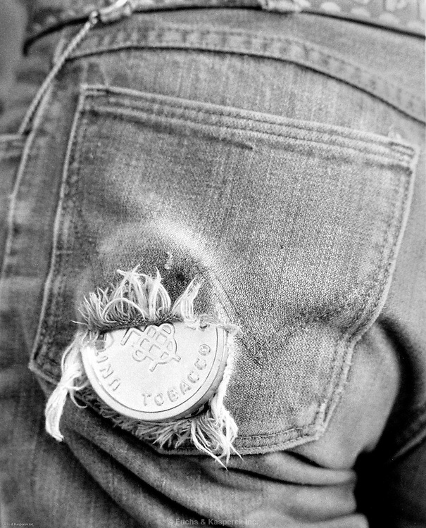 The worn pocket of a high school rodeo participant, Carthage, Miss., 1978.