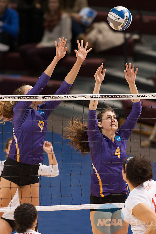 21 NOV 2015: Cal Lutheran's  Monica Lundgren, left, and Amanda Robert's leap to block a spike attempt by Wittenberg during the Division III Women's Volleyball Championship held at Van Noord Arena on the Calvin University campus in Grand Rapids, MI. Cal Lutheran defeated Wittenberg 3-0 for the national title. Erik Holladay/NCAA Photos