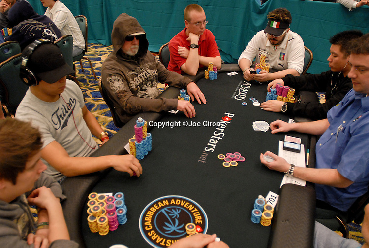 Felipe Ramos at left, on table with Max Pescatori, end of table right.