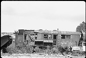 Derelict Rotary #2 in Ridgway yards with derelict Goose #2 and a wedge plow.<br /> RGS  Ridgway, CO  ca. 1950
