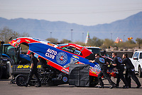 Feb 2, 2017; Chandler, AZ, USA; Crew members push the car of NHRA funny car driver Robert Hight towards the starting line during Nitro Spring Training preseason testing at Wild Horse Pass Motorsports Park. Mandatory Credit: Mark J. Rebilas-USA TODAY Sports