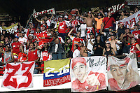 CUCUTA - COLOMBIA -07 -02-2015: Hinchas de Independiente Santa Fe, animan a su equipo durante partido entre Cucuta Deportivo e Independiente Santa Fe por la fecha 2 de la Liga Aguila I-2015, jugado en el estadio General Santander de la ciudad de Cucuta.  / Fans of Independiente Santa Fe, cheer for their team during a match between Cucuta Deportivo and Independiente Santa Fe for the date 2 of the Liga Aguila I-2015 at the General Santander Stadium in Cucuta city, Photo: VizzorImage / Manuel Hernandez / Str.