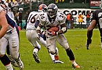 Denver Broncos running back Clinton Portis (26) on Sunday, November 30, 2003, in Oakland, California. The Broncos defeated the Raiders 22-8.