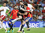 Spain's Sergio Busquets and Georgia's Lobzhanize and Revishvili during the up match between Spain and Georgia before the Uefa Euro 2016.  Jun 07,2016. (ALTERPHOTOS/Rodrigo Jimenez)
