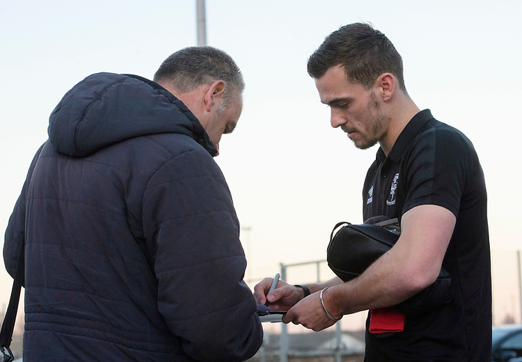 Lincoln City's Harry Toffolo signs an autograph for a fan after arriving at the ground<br /> <br /> Photographer Chris Vaughan/CameraSport<br /> <br /> The EFL Sky Bet League Two - Lincoln City v Exeter City - Tuesday 26th February 2019 - Sincil Bank - Lincoln<br /> <br /> World Copyright © 2019 CameraSport. All rights reserved. 43 Linden Ave. Countesthorpe. Leicester. England. LE8 5PG - Tel: +44 (0) 116 277 4147 - admin@camerasport.com - www.camerasport.com