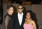 Tamara Tunie (ATWT) & Rhonda Ross (A/W) pose with designer B. Michael at his B Michael America Couture Collection - Fall/Winter collection (Fashion Show) on February 15, 2011 at the Plaza Hotel, New York City, New York. (Photo by Sue Coflin/Max Photos)