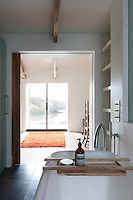 Even the bathroom has a view of the estuary through sliding windows at one side of the bedroom