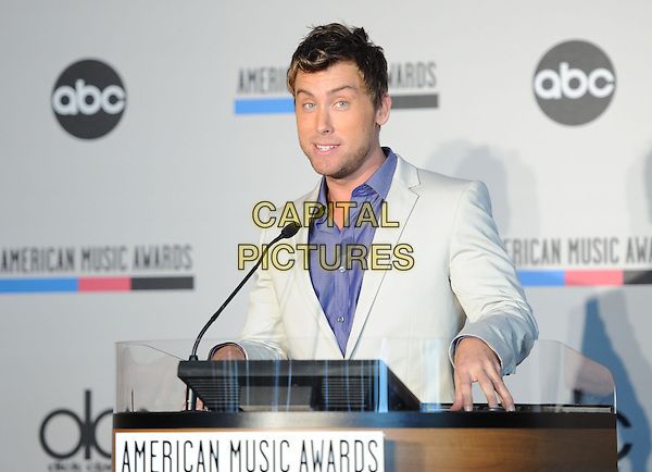 LANCE BASS .at The 2010 American Music Award Nomination Announcements held at The JW Marriott Los Angeles at L.A. Live in Los Angeles, California, USA, .October 12th 2010..half length blue shirt purple white grey gray jacket microphone speaking .CAP/RKE/DVS.©DVS/RockinExposures/Capital Pictures.