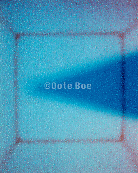 Blue triangle abstraction against lighter blue background