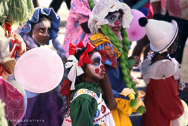 """Junior Carnival, Trinidad and Tobago, Children in the street playing """"Baby Doll"""" and """"Clown"""" mas"""