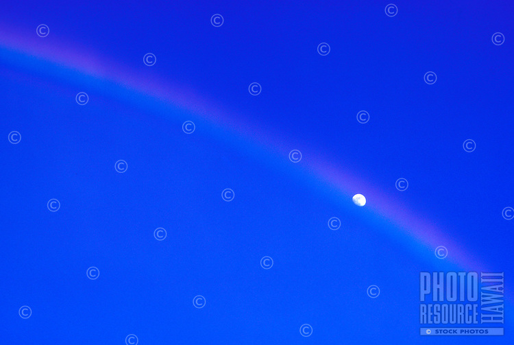 Moon peeking out of a rainbow