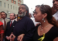 NEW YORK -- 17 August 2001 - The Rev. Al Sharpton ( center) with his lawyer Sanford Rubinstein (left) leaving the Metropolitan Detention Center after serving nearly three months of prison time for protesting U.S. naval bombing exercises on the Puerto Rican island, Vieques.<br /> <br /> Sharpton was arrested on May 1 for trespassing at a Navy firing range on Vieques. He was given a 90-day prison sentence because he had a prior civil disobedience offense on his record. He was later moved to the Brooklyn facility so he could be closer to his family. He received three days off for good behavior.