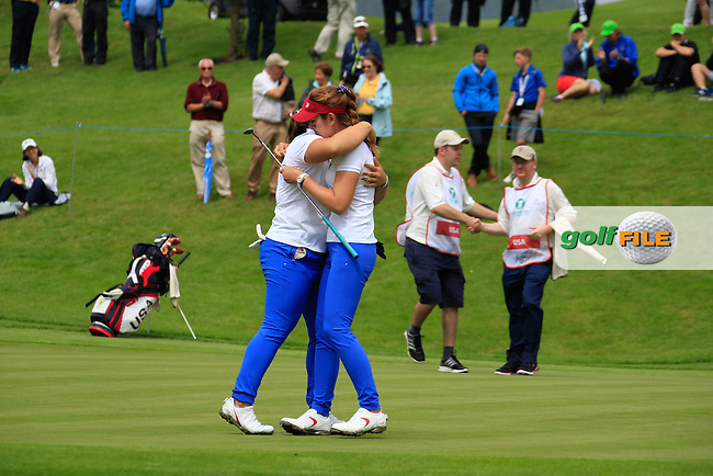 Bethany Wu and Hannah O'Sullivan on the 18th during the Saturday morning foursomes at the 2016 Curtis cup from Dun Laoghaire Golf Club, Ballyman Rd, Enniskerry, Co. Wicklow, Ireland. 11/06/2016.<br /> Picture Fran Caffrey / Golffile.ie<br /> <br /> All photo usage must carry mandatory copyright credit (&copy; Golffile | Fran Caffrey)