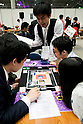 "Visitors play a card game during the Niconico Douga fan event at Makuhari Messe International Exhibition Hall on April 25, 2015, Chiba, Japan. The event includes special attractions such as J-pop concerts, Sumo and Pro Wrestling matches, cosplay and manga and various robot performances and is broadcast live on via the video-sharing site. Niconico Douga (in English ""Smiley, Smiley Video"") is one of Japan's biggest video community sites where users can upload, view, share videos and write comments directly in real time, creating a sense of a shared watching. According to the organizers more than 200,000 viewers for two days will see the event by internet. The popular event is held in all 11 halls of the huge Makuhari Messe exhibition center from April 25 to 26. (Photo by Rodrigo Reyes Marin/AFLO)"