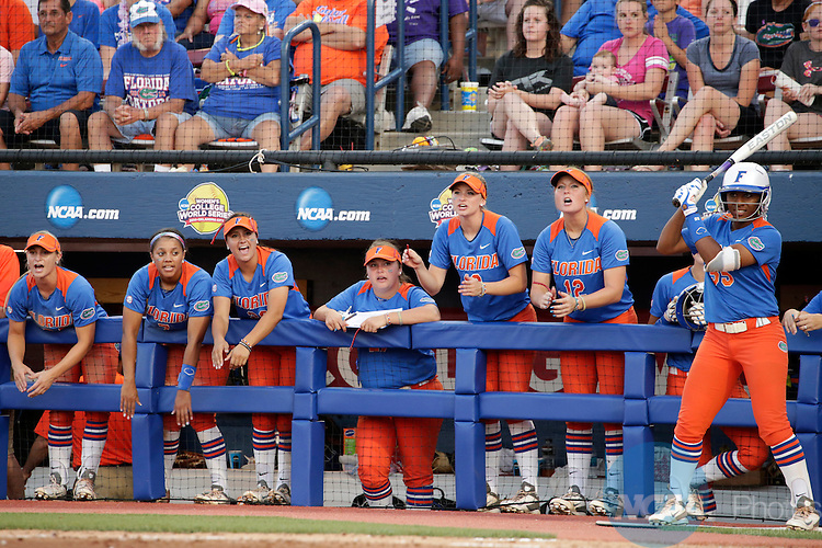 02 JUNE 2014:   The University of Florida bench cheers against the University of Alabama during the Division I Women's Softball Championship held at ASA Hall of Fame Stadium in Oklahoma City, OK.  Florida defeated Alabama 5-0 in Game One.  Shane Bevel/NCAA Photos