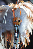 A toy-sized version of an ancient Hawaiian feathered gourd mask worn by warriors in battle. Sometimes seen hanging from a car's rear-view mirror.