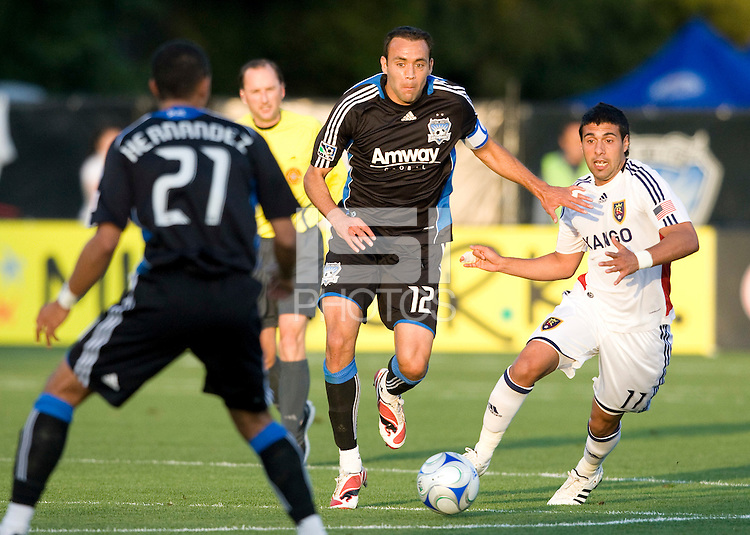 30 May 2009: Ramiro Corrales of the Earthquakes dribbles the ball away from Javier Morales of the Real Salt Lake at Buck Shaw Stadium in Santa Clara, California.   Earthquakes defeated Real Salt Lake, 2-1.