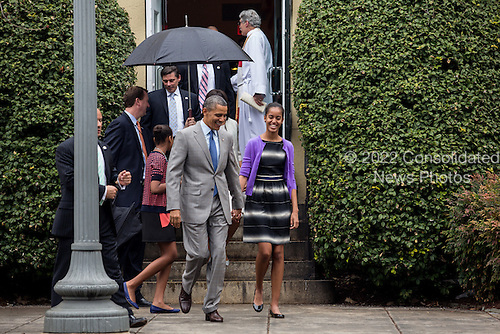 United States President Barack Obama walks with his daughter Malia after an Easter church service at St John's Episcopal Church  in Washington, Sunday, March 31, 2013. .Credit: Drew Angerer / Pool via CNP