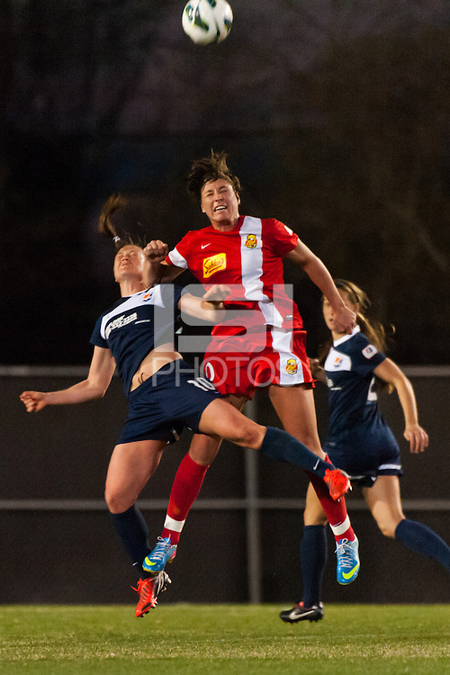 Sky Blue FC midfielder Brittany Bock (10) goes up for a header with Western New York Flash forward Abby Wambach (20). Sky Blue FC defeated the Western New York Flash 1-0 during a National Women's Soccer League (NWSL) match at Yurcak Field in Piscataway, NJ, on April 14, 2013.