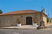 Chateau La Couspaude on a road crossing with a stone pillar and iron cross  Saint Emilion  Bordeaux Gironde Aquitaine France