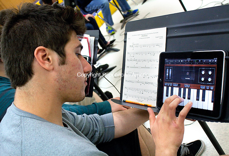 SEYMOUR MAYCT- 02 MAY 2011-050212DA04- Seymour High School student Nick Palmieri, practice the keyboard on an unconventional instrument, ipad, during his music theory class on Wednesday. The ipads will be played as part of an original composition that will be performed at the next WSO concert..Darlene Douty Republican American