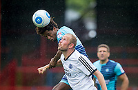 Sido Jombati of Wycombe Wanderers beats Scott Rendall of Aldershot Town in the air during the pre season friendly match between Aldershot Town and Wycombe Wanderers at the EBB Stadium, Aldershot, England on 22 July 2017. Photo by Andy Rowland.