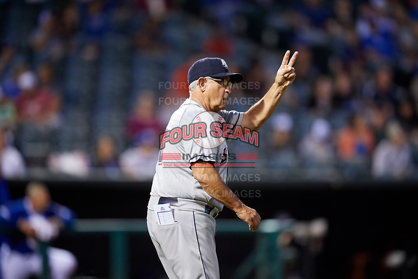 Colorado Springs Sky Sox manager Rick Sweet (16) calls for a pitching change on his walk to the mound during a game against the Oklahoma City Dodgers on June 2, 2017 at Chickasaw Bricktown Ballpark in Oklahoma City, Oklahoma.  Colorado Springs defeated Oklahoma City 1-0 in ten innings.  (Mike Janes/Four Seam Images)