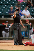 Umpire Matthew Brown calls a strike during a Southern League game between the Chattanooga Lookouts and Birmingham Barons on May 1, 2019 at Regions Field in Birmingham, Alabama.  Chattanooga defeated Birmingham 5-0.  (Mike Janes/Four Seam Images)