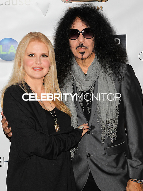 HOLLYWOOD, LOS ANGELES, CA, USA - OCTOBER 16: Regina Russell, Frankie Banali, Quiet Riot arrive at the 2014 Hollywood Film Festival - Opening Night Gala held at ArcLight Hollywood on October 16, 2014 in Hollywood, Los Angles, California, United States. (Photo by Celebrity Monitor)
