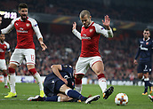 2nd November 2017, Emirates Stadium, London, England; UEFA Europa League group stage, Arsenal versus Red Star Belgrade; Filip Stojkovic of Red Star Belgrade kicking the ball out while intercepting Jack Wilshere of Arsenal in the penalty area