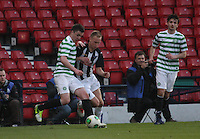 Michael Miller being pressured by Scott Mercer in the Dunfermline Athletic v Celtic Scottish Football Association Youth Cup Final match played at Hampden Park, Glasgow on 1.5.13.