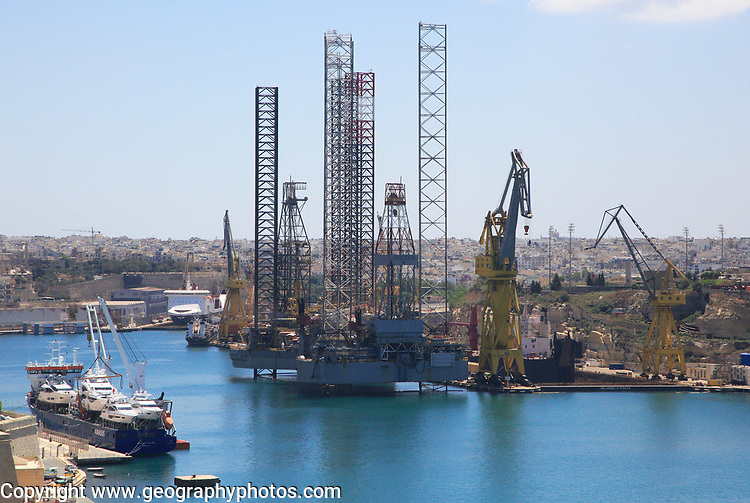 Industrial activity and cranes at  docks French Creek, China Dock, Il-Kortin,  Grand Harbour, Valletta, Malta