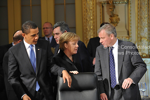 Baden-Baden, Germany - April 4, 2009 -- Heads of State and Government attend a Working Dinner at the NATO Summit in Baden-Baden, Germany on Saturday, April 4, 2009. From left to right: Barack H. Obama, President of the United States of America; Angela Merkel, Chancellor of the Federal Republic of Germany and NATO Secretary General Jaap de Hoop Scheffer..Mandatory Credit: NATO via CNP