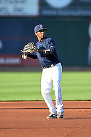 Cedar Rapids Kernels third baseman Jonatan Hinojosa (16) warmup throw to first during a game against the Quad Cities River Bandits on August 18, 2014 at Perfect Game Field at Veterans Memorial Stadium in Cedar Rapids, Iowa.  Cedar Rapids defeated Quad Cities 4-2.  (Mike Janes/Four Seam Images)