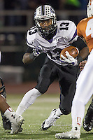 Cedar Ridge's Ron Dogan in play action against Westwood Friday at Dragon Stadium.