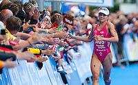12 JUL 2009 - KITZBUHEL, AUT - Emma Moffatt celebrates winning the ITU World Championship Series Womens Triathlon.(PHOTO (C) NIGEL FARROW)