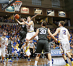 SIOUX FALLS, SD - DECEMBER 27:  Reed Tellinghuisen #23 from South Dakota State University lays the ball up past Darnell Harris #0 from Middle Tennessee State in the first half of their game at the Sanford Pentagon December 27, 2015 in Sioux Falls, South Dakota. (Photo by Dave Eggen/Inertia)