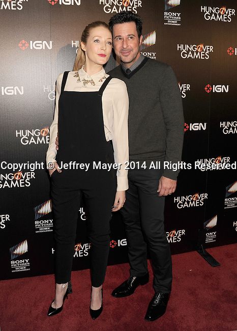 HOLLYWOOD, CA- FEBRUARY 11: Actress Jennifer Finnigan (L) and actor/husband Jonathan Silverman attend the Los Angeles Premiere of 'The Hungover Games' at TCL Chinese Theatre on February 11, 2014 in Hollywood, California.