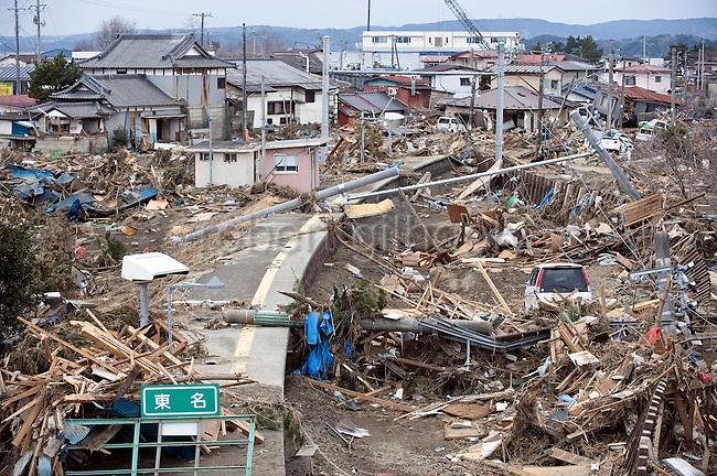 Debris covers the smashed railway station and tracks at Tona, Higashimatsushima, Miyagi Prefecture, Japan on  18 March 2011. .Photographer: Robert Gilhooly