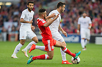 Neil Taylor of Wales tackles Valeri Kazaishvili of Georgia during the FIFA World Cup Qualifier match between Wales and Georgia at the Cardiff City Stadium, Cardiff, Wales on 9 October 2016. Photo by Mark  Hawkins / PRiME Media Images.