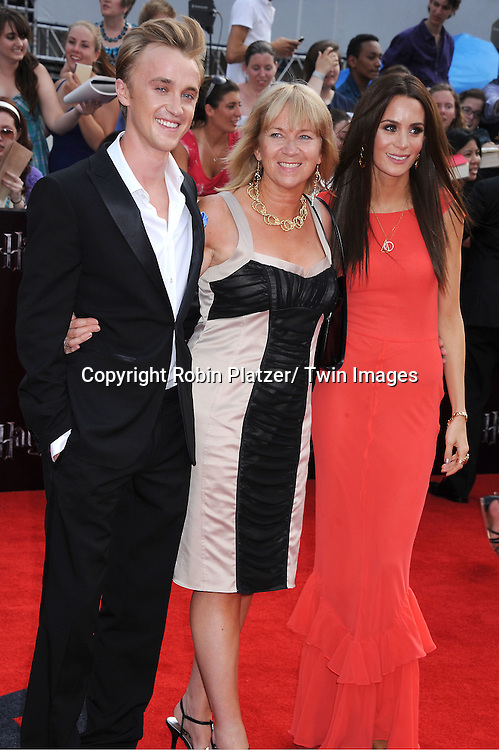 "Tom Felton and wife and mother arriving to the"" Harry Potter and the Deathly Hallows- Part 2""  North American Premiere on July 11, 2011 at Avery Fisher Hall in Lincoln Center in New York City."