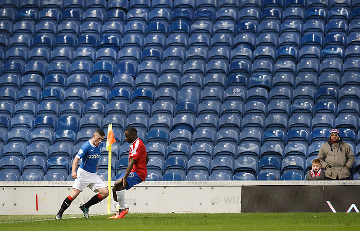 Only two fans at the Union Bears corner of the Broomloan Road stand watching Fraser Aird's trickery at the flag