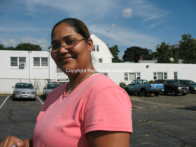 WATERBURY, CT - 29 August 2008 - 082808RA03 - Marina Villot was among the people to attend the Collaboration of Police, Government and Private Services (COPGAPS) held in the Snyder Funeral Home parking lot on Willow Street. The program encourages residents to share concerns and learn about services in the city. Villot 's concern was on pot holes and the improved plowing during winter.