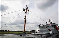 BNPS.co.uk (01202 558833)<br /> Pic: PhilYeomans/BNPS.<br /> <br /> Astonishingly when converted to DCB1 the unmanned boat could be controlled by radio waves from an aircraft up to 5 miles away.<br /> <br /> The world's first drone boat is rediscovered - after 100 years in the shadows.<br /> <br /> A historic British torpedo boat, which was converted into the world's first remotely controlled 'drone vessel' as part of a top secret project at the end of the Great War has been painstakingly researched and restored after being discovered rotting in a West country boatyard.<br /> <br /> The pioneering CMB9/DCB1 was one of 12 Coastal Motor Boats (CMBs) built by the Admiralty in 1916 to target German destroyers.<br /> <br /> The fast, lightweight 40ft motor torpedo boat, which could travel at 40 knots, sunk the German destroyer G88 off Zebrugge in Belgium in 1917.<br /> <br /> Subsequently, it was one of four vessels converted into Distance Control Boats (DCBs) for top secret trials to see if unmanned patrol boats with torpedoes could be radio controlled via aircraft and directed towards enemy targets.<br /> <br /> The boat was found in a sorry state covered in brambles in a boat yard in Weston-super-Mare, Somerset, by marine surveyor Robert Morley a decade ago, who has spent tens of thousands of pounds restoring and researching it's colourful history.
