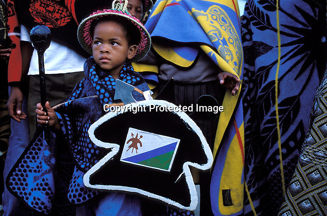 COLESOT35027.Country. Lesotho. Black boy wearing traditional clothing during the royal wedding for the King and Queen of Lesotho.  Hat, blanket with small spear and shield..©Per Anders Pettersson/iAfrika Photos