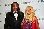 Bassist Verdine White of Earth, Wind and Fire and his wife, Shelly Clark, arrive for the formal Artist's Dinner honoring the recipients of the 42nd Annual Kennedy Center Honors at the United States Department of State in Washington, D.C. on Saturday, December 7, 2019. The 2019 honorees are: Earth, Wind & Fire, Sally Field, Linda Ronstadt, Sesame Street, and Michael Tilson Thomas.<br /> Credit: Ron Sachs / Pool via CNP