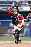 Batavia Muckdogs catcher Chris Hoo (5) looks for a pop up during the first game of a doubleheader against the Connecticut Tigers on July 20, 2014 at Dwyer Stadium in Batavia, New York.  Connecticut defeated Batavia 5-3.  (Mike Janes/Four Seam Images)