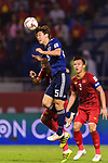 Osako Yuya of Japan (front) fights for the ball with B T Dung of Vietnam (back) during the AFC Asian Cup UAE 2019 Quarter Finals match between Vietnam (VIE) and Japan (JPN) at Al Maktoum Stadium on 24 January 2018 in Dubai, United Arab Emirates. Photo by Marcio Rodrigo Machado / Power Sport Images