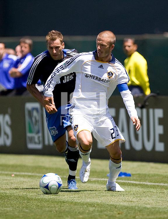 LA's David Beckham (23) controls the ball in front of San Jose's Darren Huckerby (6). San Jose Earthquakes defeated LA Galaxy 3-2. August 3, 2008, McAfee Coliseum, Oakland, CA.